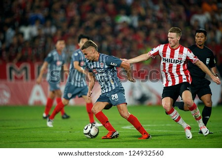 BANGKOK,THAILAND-JANUARY 8:Mario Gjurovski (L) of SCG Muangthong Utd. in action  during The AIA Champions Cup match between SCG Muangthong Utd. and PSV at SCG Stadium on Jan8 ,2012 in ,Thailand.