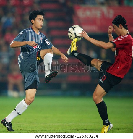 BANGKOK,THAILAND-JANUARY 22:	Piyaphon Bantao (L) of SCG Muangthong Utd.in action during The Friendly Match between SCG Muangthong Utd.and Gyeongnam FC at SCG Stadium on Jan 22, 2013 in,Thailand.