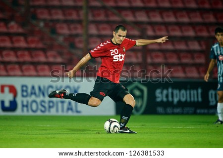BANGKOK,THAILAND-JANUARY 22:Sretenovic Sreten of Gyeongnam FC in action during The Friendly Match between SCG Muangthong Utd.and Gyeongnam FC at SCG Stadium on Jan 22, 2013 in,Thailand.