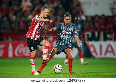 BANGKOK,THAILAND-JANUARY 8:TMario Gjurovski (R) of SCG Muangthong Utd. in action during The AIA Champions Cup match between SCG Muangthong Utd. and PSV at SCG Stadium on Jan8 ,2012 in ,Thailand.