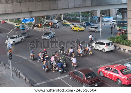 Bangkok, Thailand - January 30, 2015 :  Various vehicles break law by stop car beyond the white line on the ground during red light. This is typical behavior of people when traffic police is not strict