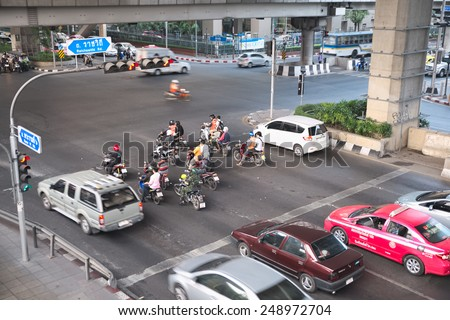 Bangkok, Thailand - January 30, 2015 :  Various vehicles break law by stop car beyond the white line on the ground during red light.