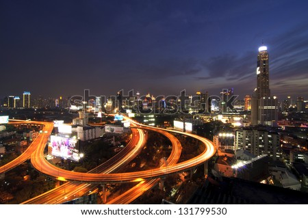 BANGKOK THAILAND - JANUARY 6 : View of Baiyok Tower II and the express way in the evening taken on January 6, 2013 in Bangkok. It is the tallest building in Bangkok with 328.4 m (1,077 ft).