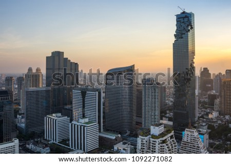 BANGKOK, THAILAND - JANUARY 20, 2017: View of MahaNakhon (the tallest building in Thailand), a mixed-use skyscraper in the Silom/Sathon central business district of Bangkok, Thailand #1092271082