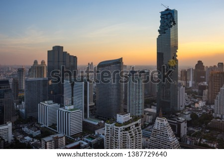 BANGKOK, THAILAND - JANUARY 20, 2017: View of MahaNakhon (the tallest building in Thailand), a mixed-use skyscraper in the Silom/Sathon central business district of Bangkok, Thailand #1387729640