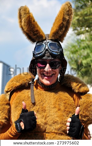 Bangkok, Thailand - January 11, 2013: Woman dressed as a furry kangaroo entertains the crowds in the Siam Paragon shopping center outdoor plaza on Children\'s Day  *