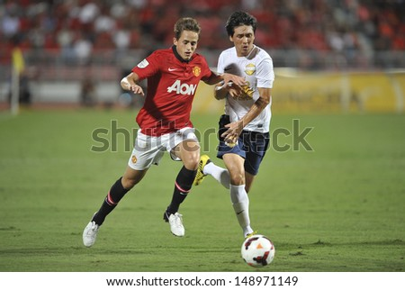 BANGKOK,THAILAND-JULY13: Adnan Januzaj(L) of Manchester United in action during the friendly match between Singha All Star and Manchester United at Rajamangala Stadium on July 13, 2013 in Thailand.