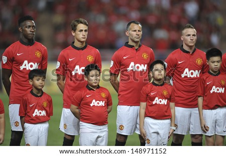 BANGKOK,THAILAND-JULY13: Adnan Januzaj(L2) of Manchester United in action during the friendly match between Singha All Star and Manchester United at Rajamangala Stadium on July 13, 2013 in Thailand.