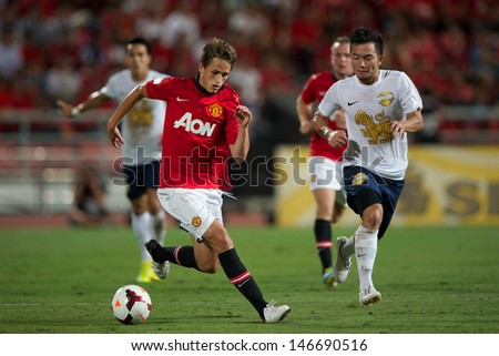 BANGKOK THAILAND-JULY13:Adnan Januzaj of Manchester United control the ball during the friendly match between Singha All Star and Manchester United at Rajamangala Stadium on July13,2013 in Thailand.