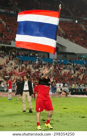 BANGKOK THAILAND JULY14:Alberto Moreno of Liverpool rises the Thailand flag  during the international friendly match Thai All Stars and Liverpool FC at Rajamangala Stadium on July14,2015 in,Thailand.