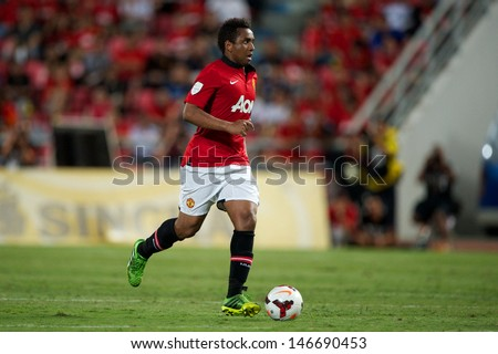BANGKOK THAILAND-JULY13:Anderson of Manchester United run with the ball during the friendly match between Singha All Star XI and Manchester United at Rajamangala Stadium on July13,2013 in Thailand.