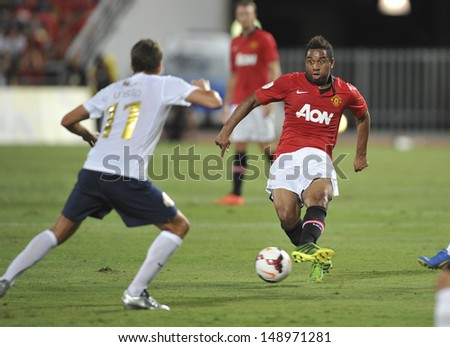 BANGKOK,THAILAND-JULY13: Anderson(R1) of Manchester United in action during the friendly match between Singha All Star and Manchester United at Rajamangala Stadium on July 13, 2013 in Thailand.