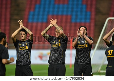 BANGKOK,THAILAND- JULY 27: Daniel Agger (c) of Liverpool FC in action during a Liverpool FC training session at Rajamangala Stadium on July 27, 2013 in Bangkok, Thailand.