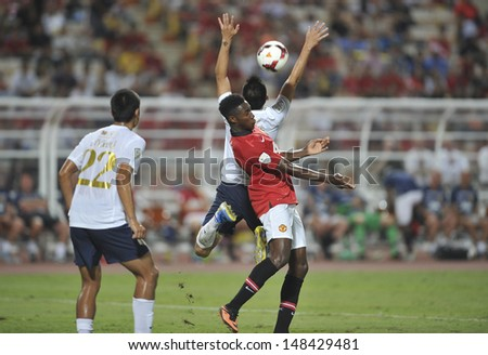 BANGKOK,THAILAND-JULY13:Danny Welbeck(R1) of Manchester United in action during the friendly match between Singha All Star and Manchester United at Rajamangala Stadium on July13,2013 in Thailand.