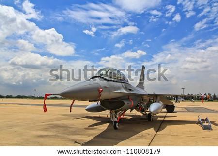 BANGKOK, THAILAND - JULY 02: F-16 of Royal Thai air force was showed in Cerebration of 100 year of Royal Thai air force (RTAF) at Don Muang airport July 2, 2012, Don Muang Airport, Bangkok, Thailand - stock photo
