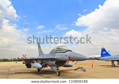 BANGKOK, THAILAND - JULY 02: F-16 of Royal Thai air force was showed in Cerebration of 100 year of Royal Thai air force (RTAF) at Don Muang airport July 2, 2012, Don Muang Airport, Bangkok, Thailand