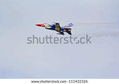 BANGKOK, THAILAND - JULY 02: F-16 of Royal Thai air force was showed in Cerebration of 100 year of Royal Thai air force (RTAF) at Don Muang airport July 2, 2012, Don Muang Airport, Bangkok, Thailand