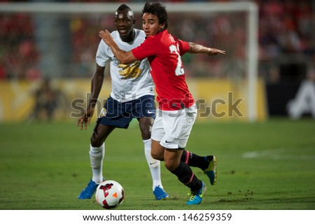 BANGKOK THAILAND-JULY13:Fabio (R) of Manchester United in action during the friendly match between Singha All Star XI and Manchester United at Rajamangala Stadium on July13,2013 in Thailand.