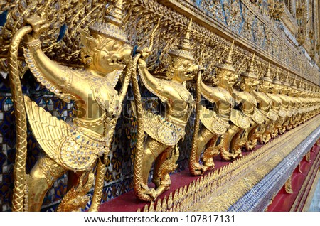 BANGKOK, THAILAND - JULY 11: Gold ornamental patter statuette in temple of emerald Buddha on 11 July 2012 at Grand Palace Bangkok,Thailand