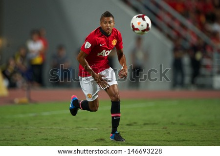 BANGKOK,THAILAND-JULY13: Jesse Lingard (R) of Manchester United in action during the friendly match between Singha All Star and Manchester United at Rajamangala Stadium on July 13, 2013 in Thailand.