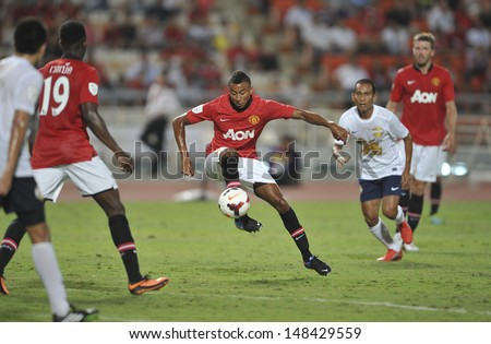 BANGKOK,THAILAND-JULY13:Jesse Lingard(R3) of Manchester United in action during the friendly match between Singha All Star and Manchester United at Rajamangala Stadium on July13,2013 in Thailand.