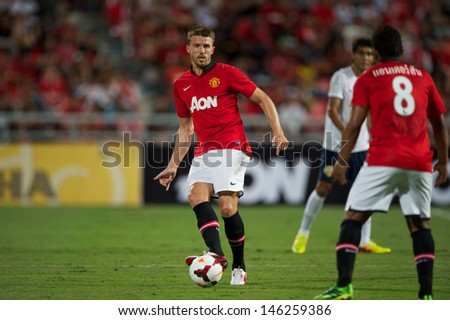 BANGKOK THAILAND-JULY13:Michael Carrick of Manchester United in action during the friendly match between Singha All Star XI and Manchester United at Rajamangala Stadium on July13,2013 in Thailand.
