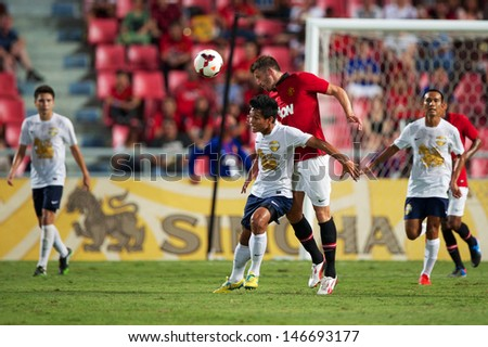 BANGKOK,THAILAND-JULY13:Michael Carrick (R2)of Manchester United in action during the friendly match between Singha All Star and Manchester United at Rajamangala Stadium on July 13, 2013 in Thailand.