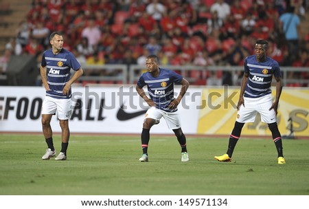 BANGKOK,THAILAND-JULY13: Patrice Evra(L2) of Manchester United in action during the friendly match between Singha All Star and Manchester United at Rajamangala Stadium on July 13, 2013 in Thailand.