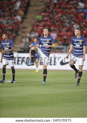 BANGKOK,THAILAND-JULY13: Phil Jones of Manchester United in action during the friendly match between Singha All Star and Manchester United at Rajamangala Stadium on July 13, 2013 in Thailand.