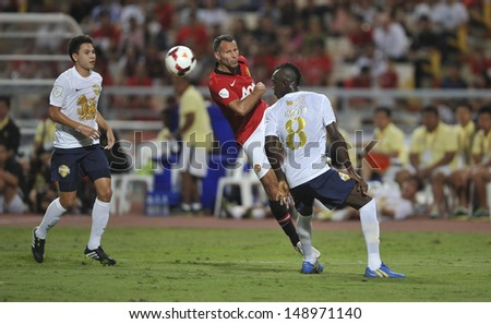 BANGKOK,THAILAND-JULY13: Ryan Giggs(L2) of Manchester United in action during the friendly match between Singha All Star and Manchester United at Rajamangala Stadium on July 13, 2013 in Thailand.