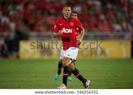 BANGKOK,THAILAND-JULY13: Ryan Giggs of Manchester United run during the friendly match between Singha All Star XI and Manchester United at Rajamangala Stadium on July 13, 2013 in Thailand.