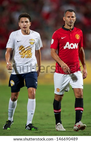 BANGKOK THAILAND-JULY13:Ryan Giggs (R) of Manchester United look on during the friendly match between Singha All Star and Manchester United at Rajamangala Stadium on July13,2013 in Thailand.