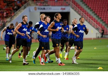 BANGKOK,THAILAND-JULY12: Ryan Giggs (R)of Manchester United with Teammates squad jog during a first team training pre-season tour of Bangkok at Rajmalanga Stadiumon July 12, 2013 in Bangkok, Thailand.