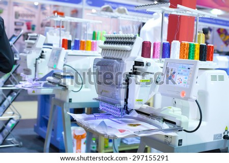 BANGKOK THAILAND JULY 11 Textile machine with colors threadsin Garment Manufacturers Sourcing Expo 2015 GFT 2015 on JULY11 2015 in Bangkok Thailand