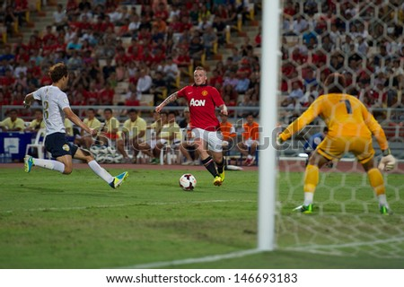 BANGKOK,THAILAND-JULY13: Tom Cleverley (C) of Manchester United in action during the friendly match between Singha All Star and Manchester United at Rajamangala Stadium on July 13, 2013 in Thailand.