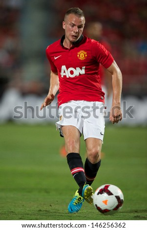 BANGKOK THAILAND-JULY13: Tom Cleverly of Manchester United looks to pass during the friendly match between Singha All Star XI and Manchester United at Rajamangala Stadium on July13,2013 in Thailand.