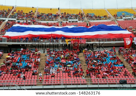 BANGKOK,THAILAND-JULY28:Unidentified fan of Thailand national flag supporters during the international friendly match Thailand and Liverpool at Rajamangala Stadium on July 28,2013 in Bangkok,Thailand.