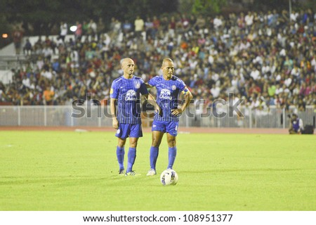 BANGKOK, THAILAND - JULY 21 : unidentified players in action at Thai Premier League (TPL) BEC Tero (red) VS Chonburi Fc. (Blue) at Thebhussadin Stadium on July 21 , 2012 in Bangkok,Thailand.