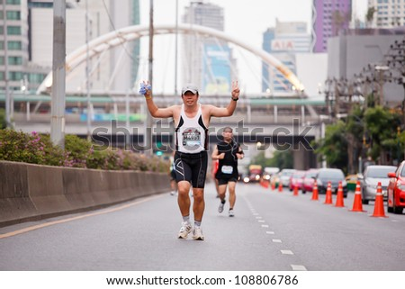BANGKOK, THAILAND - JULY 29 : Unidentified  runner competes on the street during Adidas King of the Road 2012  running championship on July 29, 2012 in Bangkok, Thailand.