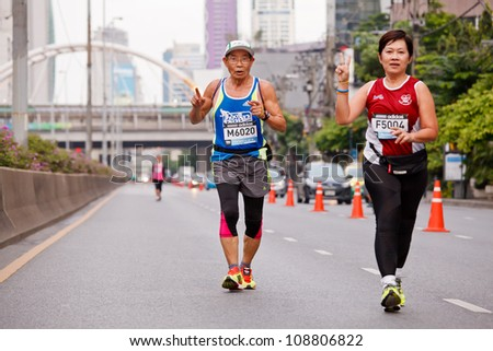 BANGKOK, THAILAND - JULY 29 : Unidentified  runner competes on the street during Adidas King of the Road 2012  running championship on July 29, 2012 in Bangkok, Thailand. - stock photo