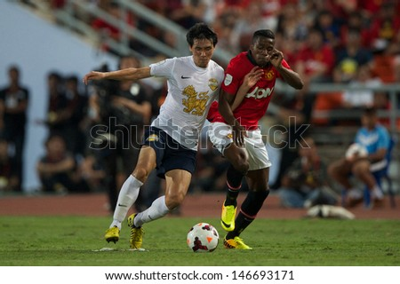 BANGKOK,THAILAND-JULY13: Wilfried Zaha (R) of Manchester United in action during the friendly match between Singha All Star and Manchester United at Rajamangala Stadium on July 13, 2013 in Thailand.