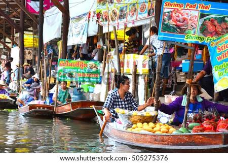 Bangkok, Thailand - Jun 11: Local beverage shop in Bangkok, Thailand on Jun 11, 2016. Local beverage shop along the canal banks in the famous Damnoen Saduak Floating Market  in Bangkok. #505275376