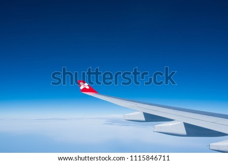 BANGKOK, THAILAND- JUNE 9: Airasia X flight flying in the air on a smooth flight with light clouds and sunny blue sky on June 9, 2018 in Bangkok, Thailand