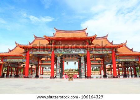 BANGKOK, THAILAND - JUNE 22: The big entry of China temple at Thumkatunyoo foundation with blue sky background ,Bangkok, Thailand. June 22, 2012.