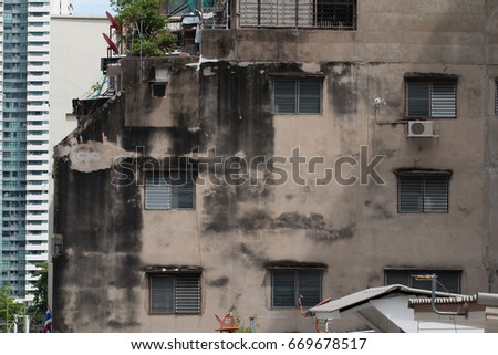 Bangkok, Thailand - June 25, 2017: Vintage dirty high building with louver windows in Silom CBD area of Bangkok #669678517