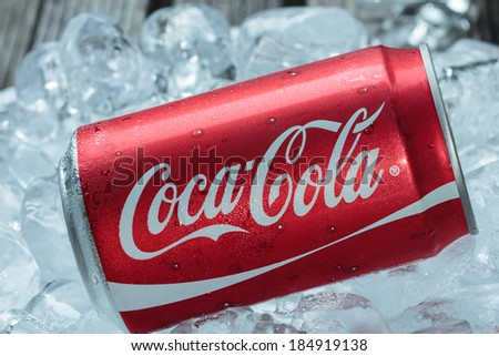 BANGKOK, THAILAND - MARCH 21, 2014 : Can of Coca-Cola on ice. Coca-Cola is the one of the worlds favorite soft drinks.