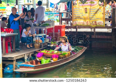 BANGKOK, THAILAND - MARCH 22, 2018: Floating market in Thailand in a summer day #1250186263