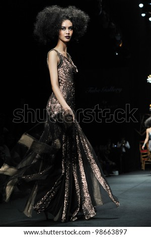"BANGKOK, THAILAND - MARCH 24 : Model walks the runway at "" Tube Gallery "" collection presentation during Siam Center Fashion Visionary Spring/Summer on March 24, 2012 in Bangkok Thailand."