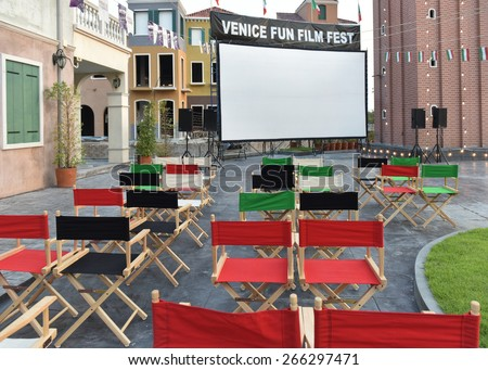 BANGKOK THAILAND - MARCH 29 : Red Chairs Film Director, The director\'s chair was placed for the movie theaters and outdoor ambience past dusk. on March 29 2015 in Bangkok Thailand.