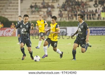 BANGKOK,THAILAND-MARCH 11: Sukri eata (Y) in action during Kor Royal Cupl (Charity) between Buriram UTD and Chonburi FC at National Stadium on March 11, 2012 in Bangkok, Thailand.